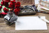 Writing a letter. White sheet of paper, ink and red carnation fl — Stok fotoğraf