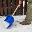 Man removing snow from the sidewalk after snowstorm — Stock Photo #47975101