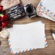 Writing a letter. Package of old letters and red carnation flowe — Stock Photo #47976841