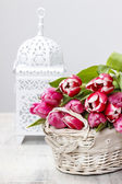Basket of beautiful pink tulips on white background. Copy space — Stock Photo