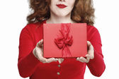 Glamorous woman holding red present box with big bow — Stockfoto