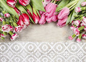 Beautiful pink tulips and carnations on wooden background — 图库照片