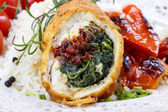 Chicken roll stuffed with spinach and dried tomatoes — Stock Photo