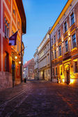 City center by night: ancient tenements, Kanonicza Street, Krako — Stock Photo