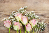Beautiful pink roses on wooden background. Top view, copy space — Stock Photo