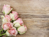 Pastel pink roses on wooden background. Copy space — Stock Photo