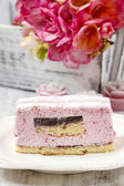 Layer cake with pink icing. Rustic box with freesia flowers in t — Stock Photo