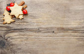 Christmas cookies on wooden background. Copy space, blank board — Stok fotoğraf