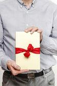 Man giving a book as a present — Stock Photo
