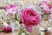Florist workplace: incomplete tiny bouquets in glass vases. Step — Stock Photo