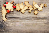 Christmas cookies on wooden background. Copy space, blank board — Stockfoto
