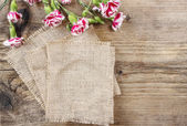Red and white carnation flowers on wooden background. Copy space — Stock Photo