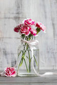 Bouquet of pink carnations in glass vase — Stock Photo