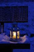 Lantern on snow — Stock Photo