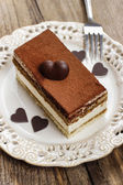 Tiramisu cake and homemade chocolate hearts — Stock Photo