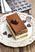 Tiramisu cake and homemade chocolate hearts — Stock Photo