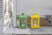 Colorful iron lanterns on rustic wooden porch — Stock Photo