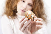 Redhead woman holding vintage locket — Stock Photo