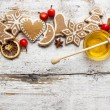 Gingerbread christmas cookies and bowl of honey on wooden table. — Stock Photo #47985343