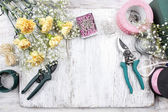 Florist workplace: flowers and accessories — Stock Photo