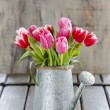Bouquet of pink and red tulips in silver watering can — Stock Photo #48065723