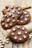 Round chocolate cookies decorated with icing stars — Stock Photo