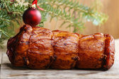 Christmas smoked ham under fir branch. Wooden background, copy s — Stock Photo