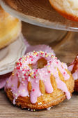 Easter yeast cake and donuts on wooden table. Traditional recipe — Stockfoto