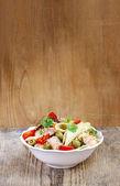 Salmon salad on wooden table — Stock Photo