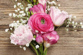 Pink persian buttercup flower, freesia flower, tulip and baby's — Stock fotografie
