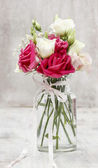 Bouquet of pink and white eustoma flowers in transparent glass v — Stockfoto