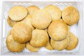 Box of fresh round buns — Stock Photo