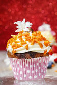 Beautiful cupcake decorated with orange sprinkles — Stock Photo