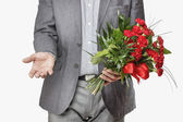 Man holding bouquet of red carnations — Стоковое фото