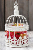 Freesia flowers in beautiful vintage birdcage. Wedding decor ide — Stock Photo