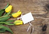 Beautiful yellow tulips on wooden background. Top view — Stockfoto