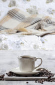 Time to relax: cup of coffee on wooden table — Stockfoto