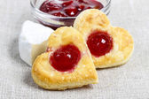 Puff pastry cookies in heart shape filled with cherries — Stock Photo