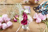 Woman making floral wedding decorations. Tiny bouquet of beautif — Stock Photo