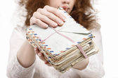 Woman holding package of vintage letters — Stock fotografie