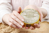 Woman holding vintage compact powder in beautiful hands — Stock Photo