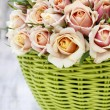 Bouquet of roses in a green wicker basket — Stock Photo #50625359
