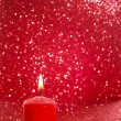 Red candle. Red glittering christmas lights. Blurred abstract ba — Stock Photo #50626061