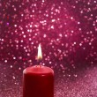 Red candle. Red glittering christmas lights. Blurred abstract — Stock Photo #50626085