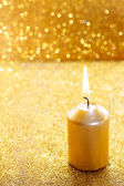 Golden candles. Gold glittering christmas lights.  — Foto de Stock