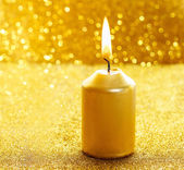 Golden candles. Gold glittering christmas lights.  — Stock Photo