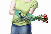 Florist holding bouquet of red carnations and garden shears. — Stock Photo