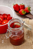 Strawberry jam in preserving glass — Stock Photo