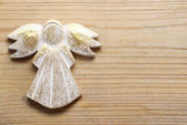 Golden angel on wooden background.  — Stockfoto