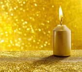 Golden candles. Gold glittering christmas lights. Blurred abstra — Stock Photo